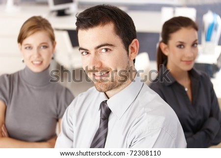 Happy team of young businesspeople smiling in office.? - stock photo