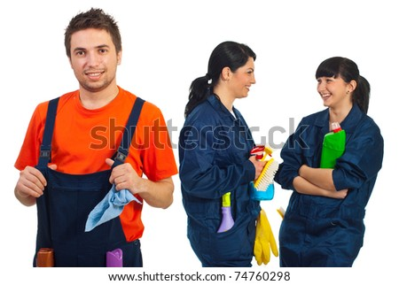 Happy teamwork of cleaning workers smiling  or laughing isolated on white background - stock photo