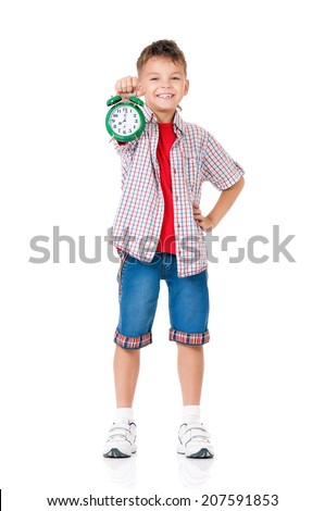 Happy teen boy with alarm clock, isolated on white background - stock photo
