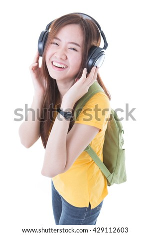 happy teen girl listening to music, full length, isolated on white - stock photo