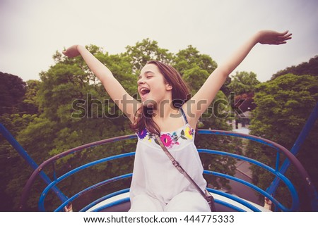 happy teen girl on panoramic wheel summer day - stock photo