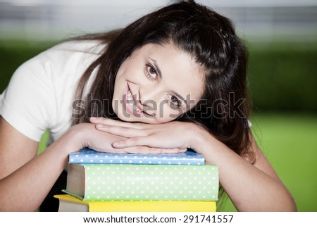 Happy teen girl with books, back to school - stock photo