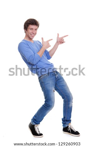 happy teen pointing at copy space - stock photo