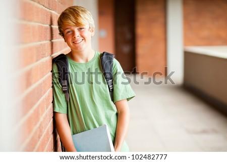 happy teen student in school - stock photo