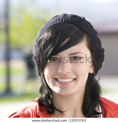 Happy teen with cap - stock photo