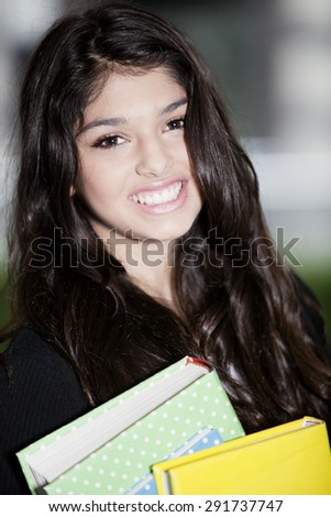 Happy teen woman with books - stock photo