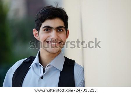 Happy teenage boy posing - stock photo