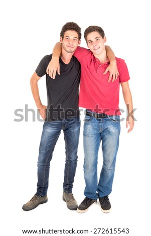 Happy teenage brothers hugging isolated in white - stock photo