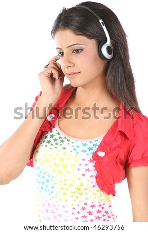 Happy teenage girl listening music - stock photo