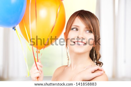 happy teenage girl with balloons at home - stock photo