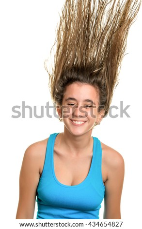 Happy teenage girl with her hair floating on the air - Isolated on white - stock photo