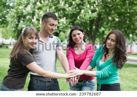 Happy Teenage Group with Hands on Stack, college, relaxation - stock photo