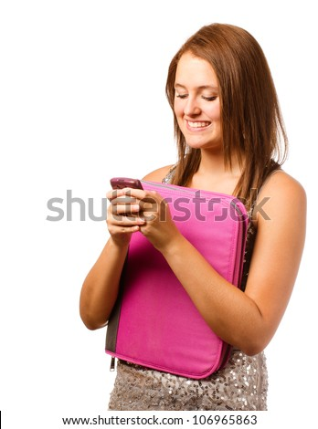 Happy teenage schoolgirl smiling and texting with cell phone isolated on white - stock photo