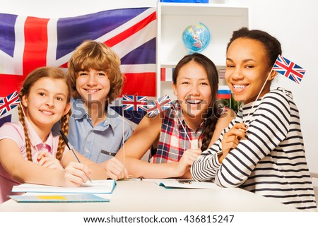 Happy teenage students at language courses - stock photo
