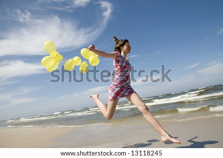 Happy teenager with balloons - stock photo