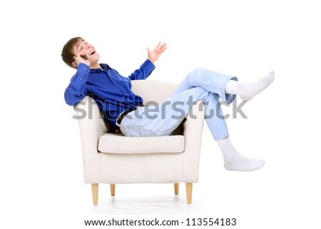 happy teenager with mobile phone in a chair. isolated on the white background - stock photo