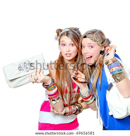 Happy teenagers Fashion girls wearing funky accessories whilst shopping - stock photo