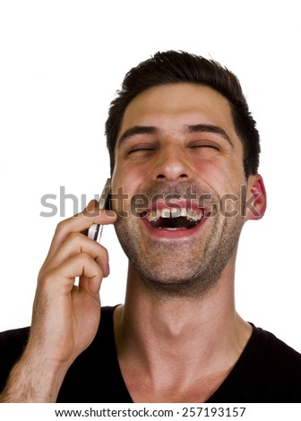 Happy telephoning - Young adult is happy while talking on the telephone. - stock photo