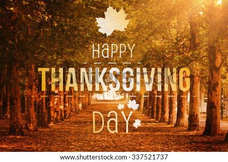 Happy thanksgiving against autumn scene - stock photo