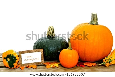 Happy Thanksgiving card with harvest vegetables on white background - stock photo
