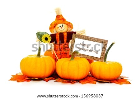 Happy Thanksgiving card with scarecrow and pumpkins     - stock photo
