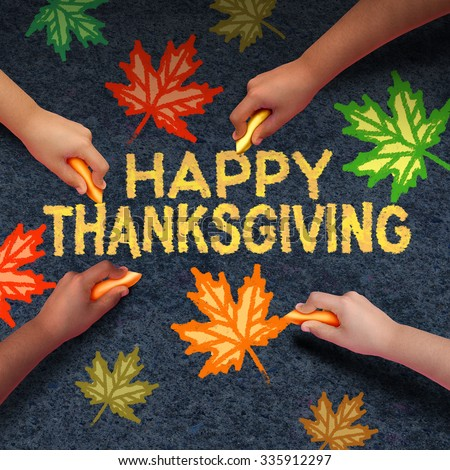 Happy thanksgiving day concept as a group of diverse people drawing using chalk on asphalt the word for traditional family get together during autumn season and community fall celebration.. - stock photo