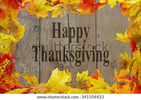 Happy Thanksgiving Message, Autumn Leaves with grunge wood with text Happy Thanksgiving - stock photo