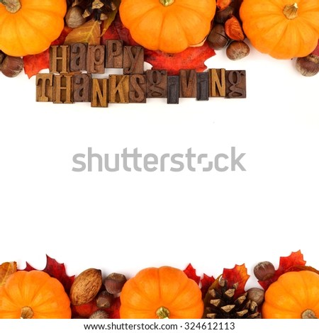 Happy Thanksgiving wooden letterpress with autumn double border of pumpkins, leaves and nuts isolated on white - stock photo