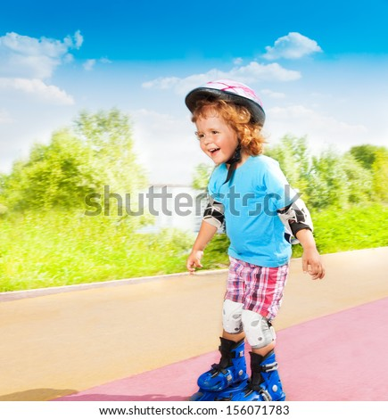 Happy thee 3 old boy rollerblading and rushing downhill on rollers in the park on sunny summer day - stock photo