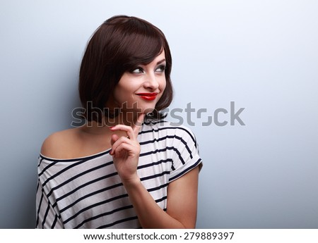 Happy thinking young woman looking on empty copy space. Closeup portrait - stock photo