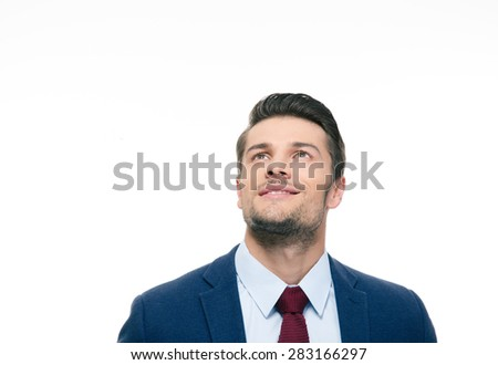 Happy thoughtful businessman looking up at copyspace isolated on a white background - stock photo