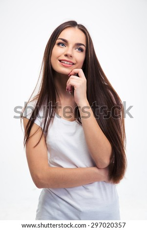 Happy thoughtful woman looking away isolated on a white background - stock photo