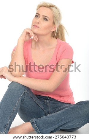 Happy Thoughtful Young Woman in Her Twenties Sitting on the Floor Relaxing and Attractive - stock photo