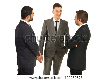 Happy three business men having conversation isolated on white background - stock photo