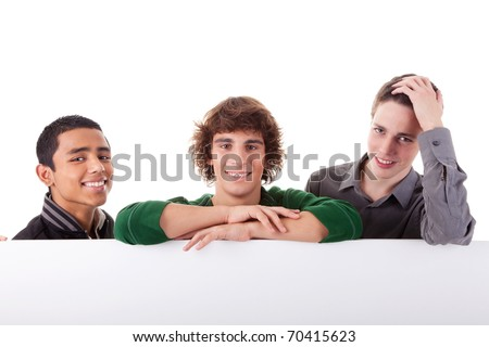 happy three young, of different colors man with a white board, isolated on a white background - stock photo