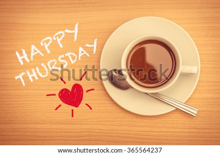 Happy Thursday with coffee cup on table  - stock photo