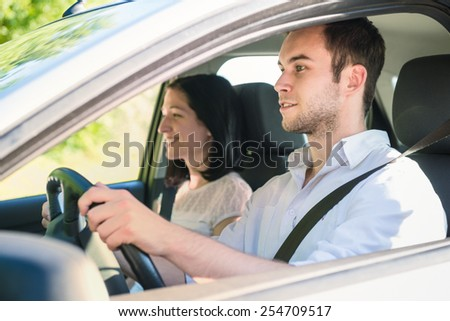 Happy time together - couple in car, man is driving - stock photo