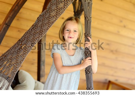 Happy toddler child girl on lace chair having fun portrait - stock photo