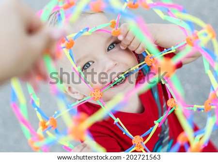 happy toddler child playing outdoors - stock photo