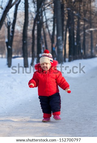 Happy toddler  in winter day - stock photo