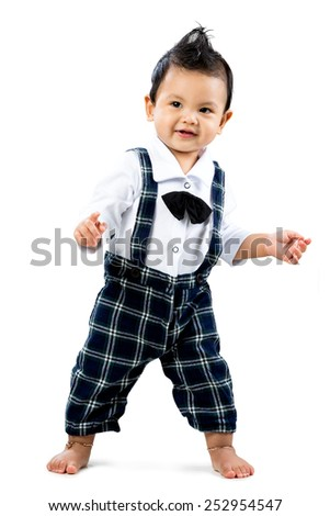 Happy toddler learning to walk, Isolated over white - stock photo