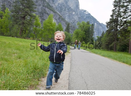 Happy toddler running in the park - stock photo