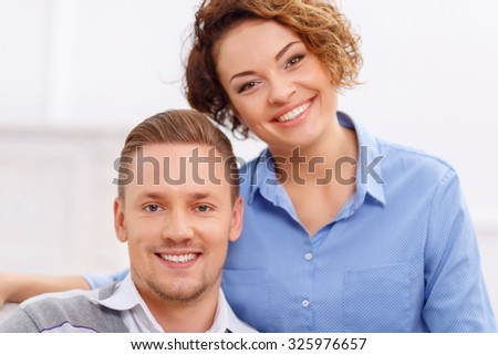 Happy together. Overjoyed nice young smiling couple expressing affection and bonding to each other  - stock photo