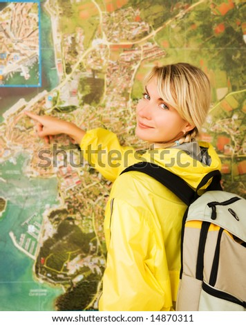 Happy tourist near the map - stock photo