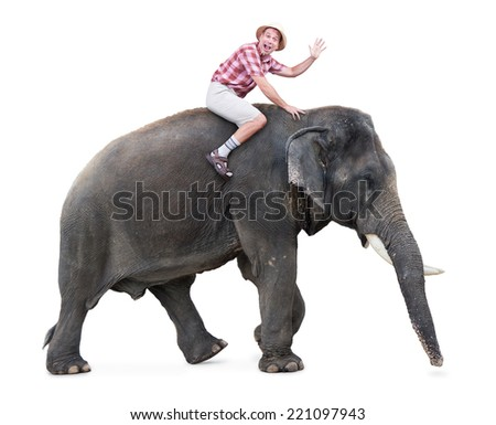 happy tourist rides on an elephant and waving with hand  - stock photo