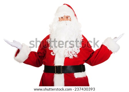 Happy traditional Santa Claus showing a copyspace. - stock photo