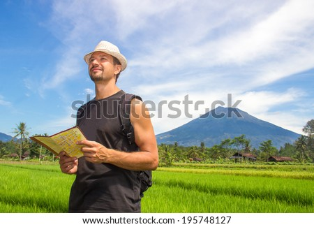 happy traveler with map in hand - stock photo