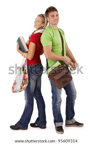 Happy trendy college students with bags and books, posing together, smiling at camera, cutout on white.? - stock photo