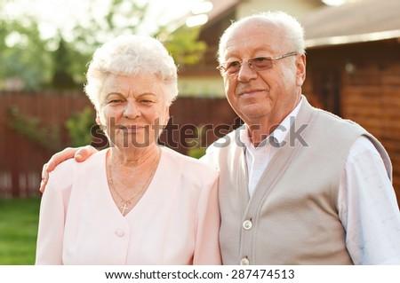 Happy trendy retired senior couple posing  - stock photo