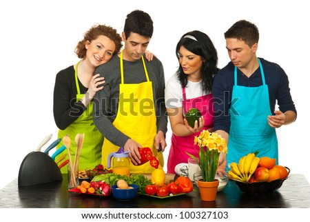 Happy two couples cooking together in kitchen - stock photo